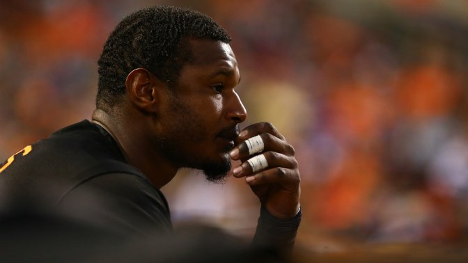 Fans' Slurs At Adam Jones Just A Small Part Of Baseball's Racial History