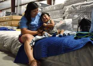 Nick Oxford of Reuters captured this photo of Maria Lopez and her son Rafael, finding a place to dwell after being forced from their Houston home. In wake of hurricane Harvey, Gallery Furniture opened its doors to many in need of a place to lay their heads.